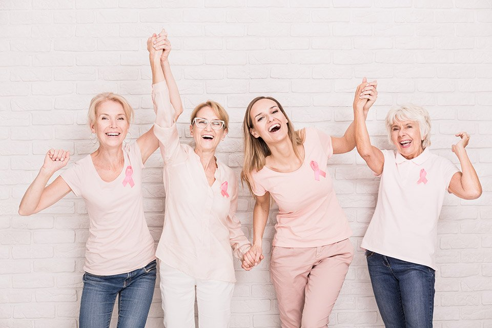 breast cancer survivors holding hands