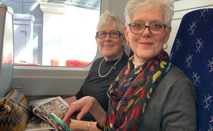 Maridith Geuder and her twin sister on a subway on vacation